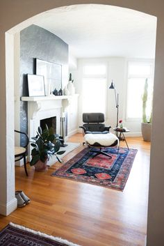 Wall diff color? Simple mantle? House Tour: A Chic and Airy Marina District Apartment | Apartment Therapy
