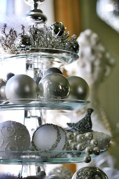 Christmas vignette using tiered cake stand and ornaments.  Ends up shaped like a Christmas tree.