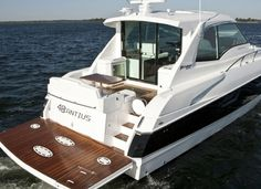 Cruisers Yachts 48 Cantius: Both the swim platform and the cockpit of the 48 Cantius are huge making the boat very practical for cruising and entertaining. Note the three-panel glass bulkhead and sliding doors separating the cockpit from the cabin.