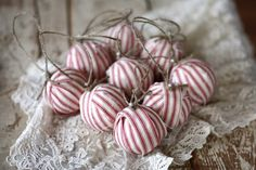 "Red ticking rag ball Christmas tree ornaments - 2 1/2"" styrofoam balls are covered in red ticking fabric for a rustic look and feel. Jute twine added for hanging. Approx. 6-7"" long when hanging {including twine}."