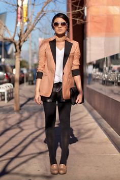 Los Angeles Who : A local actress What : Camel and black make a powerful pair in this ensemble. Wear : Queen's Wardrobe blazer, Urban Outfitters shorts, American Apparel shirt, Aldo shoes, ASOS clutch   Read more: Global Street Style - Discover More Street Style - ELLE  Visit us at ELLE.com