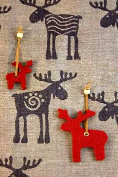 Swedish felt Christmas decorations on a reindeer tea towel.. love the background opens up other possibilities....!