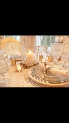 Cut glass stemware and China table setting.
