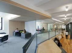 Purpose - elevated lounge brings employees closer high windows