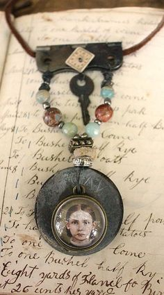 cinnamon creek dry goods....Sweet Girl Assemblage Necklace....She's a Sweet Girl Assemblage Necklace old portrait under bubble glass, mixed metals, jasper beads, old watch face, key and hinge on leather....45 -