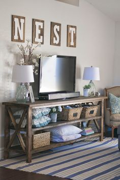 Beautiful living room decor - love the console and nest letters