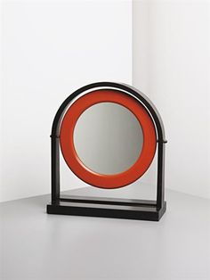 ETTORE SOTTSASS JR Table mirror, 1965  Ebonised wood, lacquered wood, plastic, mirrored glass, brass. 48.5 x 41 x 17 cm. (19 1/8 x 16 1/8 x 6 3/4 in.) Manufactured by Poltranova, Italy.