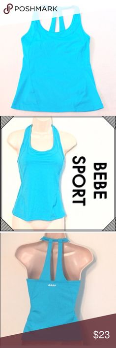 """❣BOGO 1/2 off❣🆕 Bebe Sport electric blue tank top NWOT, flawless. Built-in bra. Nylon & spandex. Size XS. Stretchy & fitted. Measures approx 23"""" long, 14.5"""" flat across chest. 🔴Bundle to save! 🔴NO TRADES, no modeling. 🔴REASONABLE offers welcome via offer button. Smoke-free home. Fast shipping! bebe Tops Tank Tops"""