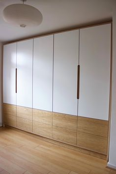 This is one of our recent projects- a fitted bespoke wardrobe featuring birch plywood carcass, laminated doors, oak veneer push to open drawers and finger pull handles. Wardrobe Laminate Design, Wall Wardrobe Design, Wardrobe Door Designs, Bedroom Closet Design, Bedroom Furniture Design, Closet Designs, Master Bedroom Wardrobe Designs, Modern Wardrobe, Wardrobe Door Handles