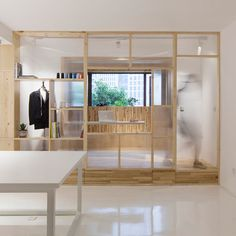 Chinese architect Cao Pu helped a couple reconfigure their awkward workspace in Nanjing by adding a series of translucent screens.
