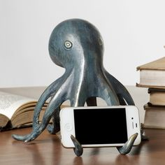 A decorative and functional Octopus Cell Phone Holder & Bluetooth Speaker. Speaker located in the head. Use indoors or sheltered locations only. Contains: Speaker, bluetooth receiver & AC power cord. Iphone Holder, Iphone Stand, Cell Phone Holder, Smartphone Holder, Iphone Phone, Gadgets, Iphone S6 Plus, Le Kraken, Motif Art Deco