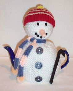 Do you wanna knit a snowman? This is a charming snowman tea cosy knitting pattern with his pompom hat and scarf – the perfect wintery tea cosy.  http://www.teacosyfolk.co.uk/show.php?id=2