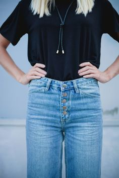 High waisted jeans all the way! | The wider strider jean and playing favorites tee by Nasty Gal
