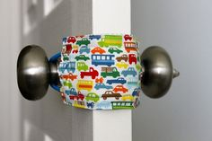 Simply brilliant ... the end to slammed doors.  Latchy Catchy comes in patterns for all ages and gender.  $8  http://www.etsy.com/listing/91548510/latchy-catchy-the-original-door-jammer    I just had 2 doors slam today because I have the windows open on a windy day.  It felt like something pierced my heart when I was startled by the doors slamming.  I could have avoided that with a couple of Latchy Catchy.  http://www.etsy.com/listing/91548510/latchy-catchy-the-original-door-jammer