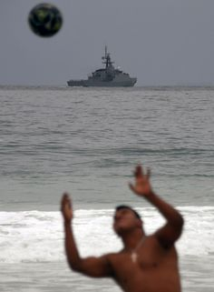#RIO2016 People play football at Copacabana beach in Rio de Janeiro on July 21 while a warship stays in background Brazil 2016 Olympic Games will start on...