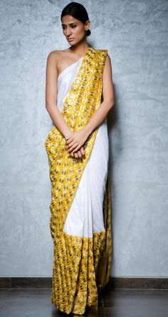 White and gold half and half silk sari with an embroidered yellow pallu by NIKHIL THAMPI http://www.perniaspopupshop.com/lakme-fashion-week/nikhil-thampi/nikhil-thampi-white-and-gold-sari-nktlfw081306.html