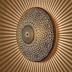 This beautiful handmade piece can be a sconce, ceiling light or a lampshade, depending on your liking and where youd like to place it. Its unique and traditional design with a lovely geometrical pattern will add to your home a beautiful and warm touch.