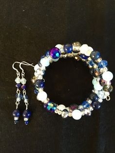 Lapis lazuli ;Swarovski crystal ;Matsuno seed beads. Opal crystals ;  Memory Wire bracelet and matching earrings  Sterling silver earring hooks