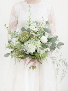 An all white wedding bouquet is very traditional.  Yet this bouquet featured today from Little Botanica feels anything but.  We love it's variety of flowers and greens and its slightly wild look as if the flowers were just cut from a field, gathered up and tied with ribbon.  The greens add a beautiful contrast and …