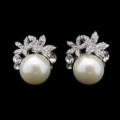 Chic, elegant and very glamorous faux pearl earrings with clear crystals and an ivory pear on a silver tone finish - Perfect for that special occasion.  http://www.nisparkle.co.uk/ourshop/prod_2020762-Chic-Faux-Pearl-Crystal-Earrings-in-Ivory-ER77.html