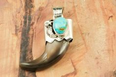 "Genuine Turquoise and a Real Bear Claw set in Sterling Silver Pendant. Free 18"" Sterling Silver Chain with Purchase of Pendant. Created by Navajo Artist Kathy Yazzie. Signed by the artist. $87.00"
