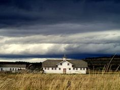 The Peter Yegen barn on the the West End of Billings -- that's a typical huge Montana storm sky.