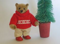 "Paula Strethill-Smith: Sebastian is 3.5"" high miniature teddy bear created from quality German mohair.Little Sebastian is very snug in a vintage wool jumper and cream wool trousers.He wears our signature leather shoes in a lovely warm red leather."