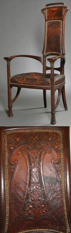 Art Nouveau armchair, early 20th century, oak, leather, brass, wood inlays. The openwork crest over an inlaid landscape scene and a fruit-and-leaf tooled leather splat, original seat upholstery, ht. 50 3/4 in.