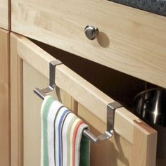 A handy rail that clips over a kitchen cabinet door or drawer to hold drying-up cloths, hand towels etc. Neat huh!
