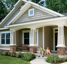 I like the pillars with a small bit of stone as a base. This might match up with the stone running from the sill down on the house.