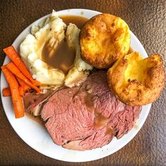 Herb and Garlic Crusted Prime Rib Roast with Burgundy Thyme Gravy. A real celebration meal and comfort food classic is welcome at Sunday dinner any time. #sundaydinner #perfectroastbeef #easyroastbeef #beefrecipes