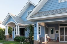Light blue home with light gray roof shingles. Not my favorite shade of blue for a home. I much prefer a dark blue. House Paint Exterior, Exterior Paint Colors, Exterior House Colors, Paint Colors For Home, Bungalow Exterior, Grey Exterior, Roof Shingle Colors, Roof Colors, Deck Colors