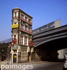 It seems very strange that The Black Friar pub, next to Blackfriars station, has managed to survive and stranger still that it has survived as a pub with it's Art Nouveau interior intact. The Grade II pub was built around 1875 and was remodelled by Henry Poole in 1905. Pictured here in 1966, it already looks long cast adrift and exposed from the narrow streets in which it was built. It was during this period that the pub was saved from demolition by Sir John Betjeman. 26th March 1966
