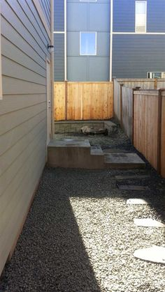 No-maintenance landscaping example in Tumwater Hill. Included cedar privacy fence, rock garden and landscape beds. Privacy Fences, Fencing, Low Maintenance Landscaping, Cedar Fence, Townhouse, Modern Design, Garage Doors, Backyard, Landscape