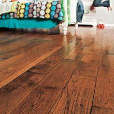 distressed wood flooring in a girls bedroom