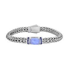 MSRP: $699.99  Our Price: $499.99  Savings: $200.00    Item Number: PGCX938-0750  Availability: Usually Ships in 5 Business Days    PRODUCT DESCRIPTION:    Designed by Phillip Gabriel and expertly handcrafted in Fine Sterling Silver, this bracelet features an intricately hand-woven design with Blue Chalcedony trimmed in Blue Sapphires. Each bracelet requires a tremendous amount of time and craftsmanship to create.    FEATURES:    Crafted in Fine Sterling Silver  Designed By Phillip Gavriel…