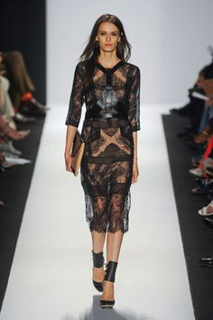 BCBG Spring 2013  A departure from fall's sportier take, a lace cocktail dress had a ladylike quality, slightly undone by its sculptural leather harness detail.