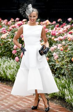 Winner of the Darby Day Myer Fashions on the Field Brodie Worrell. Melbourne Cup Carnival 2014.