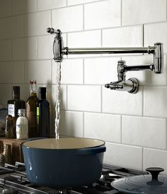 The Traditional pot filler kitchen faucet from DXV is classically styled and a luxurious addition to a traditionally styled kitchen. Built In Furniture, Kitchen Furniture, Kitchen Interior, Kitchen Cabinet Design, Modern Kitchen Design, Kitchen Island On Wheels, Pot Filler Faucet, Narrow Shelves, Home Decor Accessories