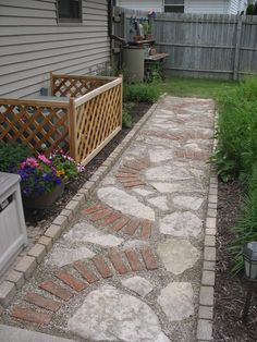 Used old bricks & broke up the larger flagstone that we had in the path previous. Filled in with crusher dust & pea stone. Brick Pathway, Stone Path, Small Gardens, Outdoor Gardens, Garden Stepping Stones, Old Bricks, Brick Patios, Flagstone, Garden Projects