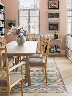 Dining rooms should be sociable and welcoming spaces. A large rug underneath the table creates a separate zone for eating while a movable bar cart is perfect for a post-dinner drink or two.