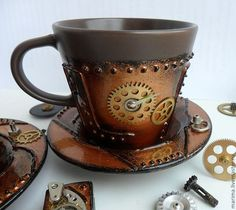 I would start drinking tea everyday with this    steampunk coffee.  Love this cup/saucer.