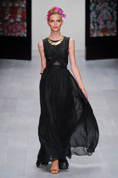 Issa 2013  Long black dress large gold necklace beautiful hair with orchids Ligh make up red lips