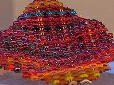 Art Of Woven Glass. Artists Thom Norris and Eric Markow create seemingly impossible shapes out of hand-woven glass. Correspondent Serena Altschul visited their Virginia studio for a look at their intricate creations.