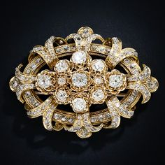 Twelve-and-a-half carats of old mine-cut diamonds sizzle in all directions in this fantastic antique diamond clip brooch, finely crafted in rich 18 karat yellow gold.  Price: $24,750.00