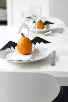 Here's a Halloween mash-up that's perfect for the table (or a mantel, or a window ledge): tiny gourds with black cardboard bat wings attached.