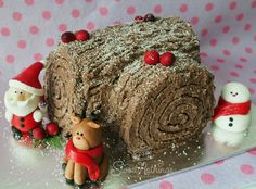 Christmas is my favourite holiday. So, here's my take on Christmas log cake. This bake consists of chocolate swiss roll with homemade cranberry jam, decorated with sugar figurines and icing sugar. #merrychristmas #christmascake #logcake #fondantfigurines #santa #snowman #reindeer