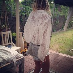 denim shorts and lace blouse