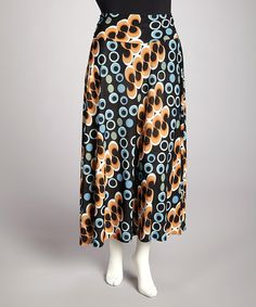 Sashay in style with this maxi skirt. Made with a hint of stretch and a posh print, a beautiful base to an effortless ensemble awaits.Measurements (size 1X): 37'' long92% polyester / 8% spandexHand wash; hang dryMade in the USA
