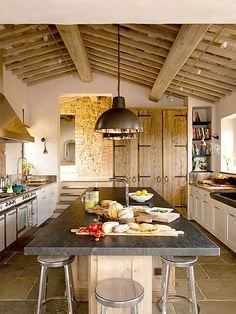 This ancient villa in Val d'Orcia, Tuscany has been renovated into a stylishly comfortable home. Incorporating the old stone, wood beams and bricks with new features, it has that wonderful rustic meet